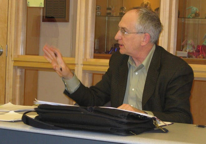 Mike Lozon answers a question during a writing workshop in 2009 at Herrick District Library.