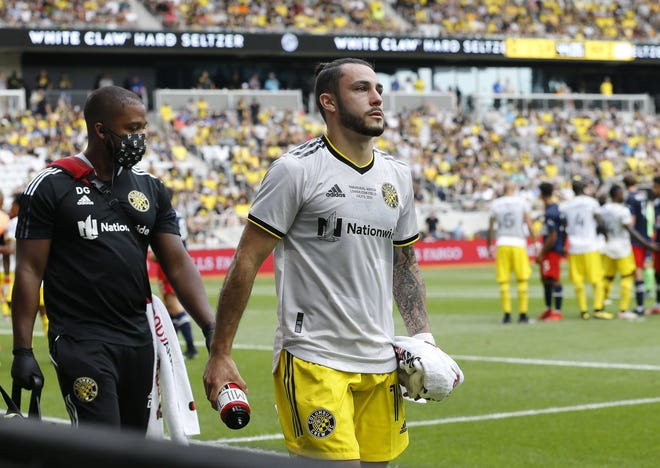 Columbus Crew defender Milton Valenzuela (19) leaves the field with an injury during the first half of the inaugural match against the New England Revolution at lower.com Field in Columbus on Saturday, July 3, 2021.