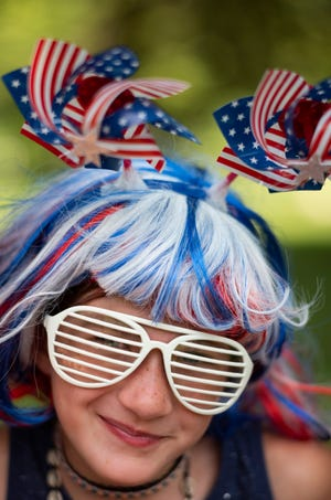 Stella Woosley, 8, of Westerville, poses for a portrait before the Doo Dah Parade on Sunday.