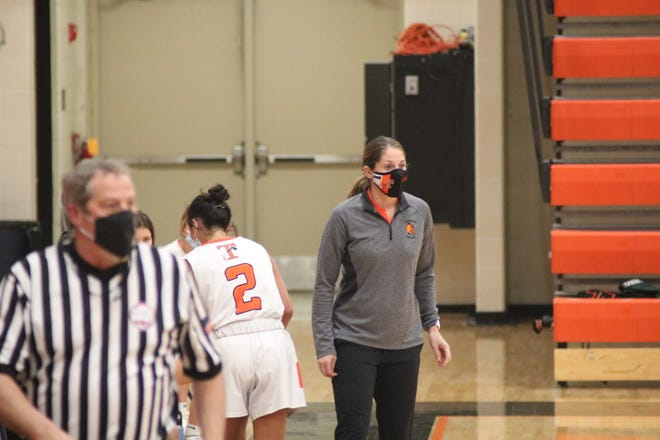 Tecumseh girls basketball coach Kristy Zajac reacts during her team's SEC White game against Adrian in Tecumseh on Feb. 22 of this year.