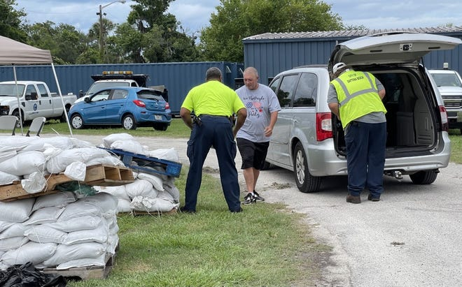 Clint Green who lives just north of Daytona showed up at the city's public works compound at 950 Bellevue Avenue on Sunday to get bags of sand. Green said he lives in an area that floods and was preparing for Tropical Storm Elsa's rains. July 4, 2021.