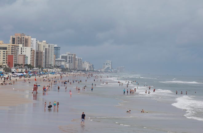 A crowd gathered at the beach near the Dunlawton approach in Daytona Beach Shores. July 4, 2021. Volusia County beach officials said Independence Day crowds this year were not as large as in previous years. Weather and an approaching tropical storm may have contributed to that.
