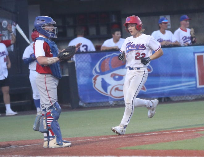 Brady Kreutzer comes home for a run during the final of the Wild West Fest Tournament on Saturday.