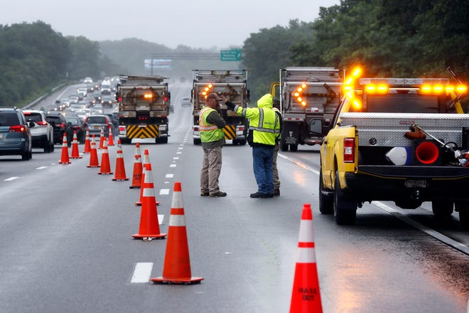 Traffic on Interstate 95 is diverted in the area of an hourslong standoff with a group of armed men that partially shut down the highway, Saturday, July 3, 2021, in Wakefield, Mass.