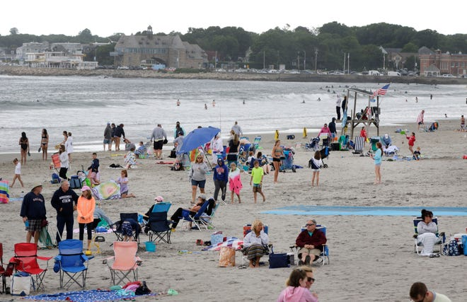Sweatshirts were beach attire during the Fourth-of-July holiday weekend this year, as seen in this photo from Narragansett Town Beach on Sunday.