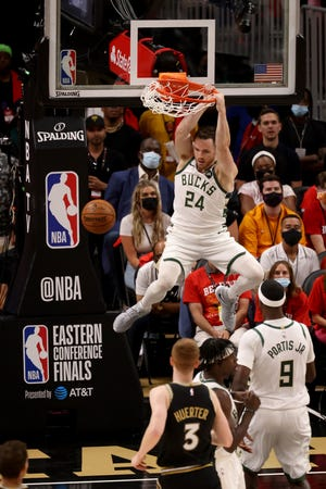 Jul 3, 2021; Atlanta, Georgia, USA; Milwaukee Bucks guard Pat Connaughton (24) dunks in the first half against the Atlanta Hawks in game six of the Eastern Conference Finals for the 2021 NBA Playoffs at State Farm Arena. Mandatory Credit: Jason Getz-USA TODAY Sports