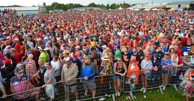 Thousands of Donald Trump fans turned out for his Sarasota rally July 3, despite heat and pouring rain.
