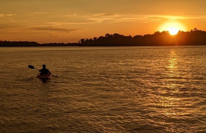 Even before the fireworks started Saturday night a Richmond Lake, the sky was beautiful. Silhouetted in the sunset in a kayak is Marcia Sebert-Lewis.