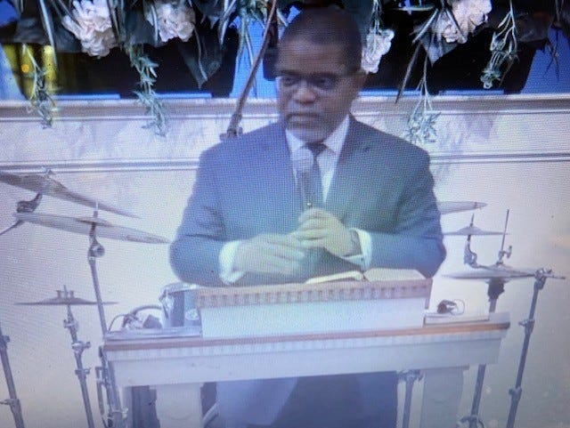 The Rev. Adrian S. Taylor, lead pastor of Springhill Baptist Church, delivers the sermon during the church's Sunday morning worship service held in person and via Facebook and YouTube.
