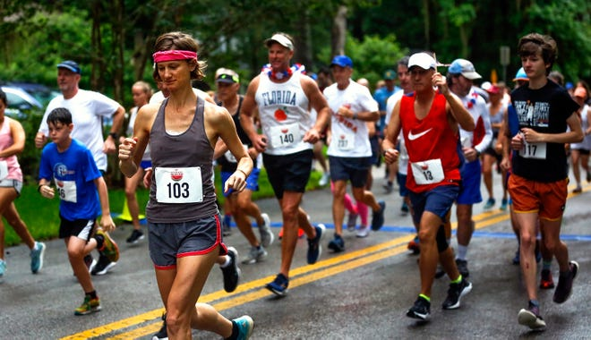 Runners take off at the start of the 43rd Annual Jack Gamble Melon Run on Sunday at Westside Park in Gainesville. [Chasity Maynard/Special to The Sun]
