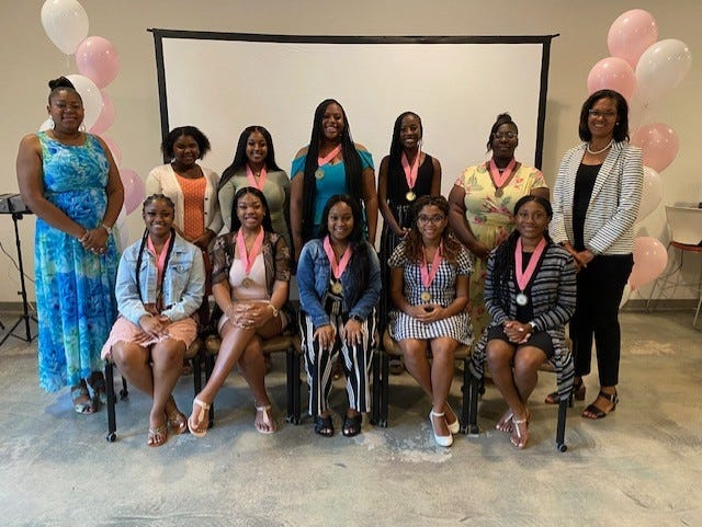 The Twenty Pearls Foundation and the Mu Upsilon Omega chapter of Alpha Kappa Alpha Sorority Inc. awarded a total of $13,500 in scholarships to 12 academically talented Alachua County high school graduates. Scholarship recipients and AKA members are pictured here.