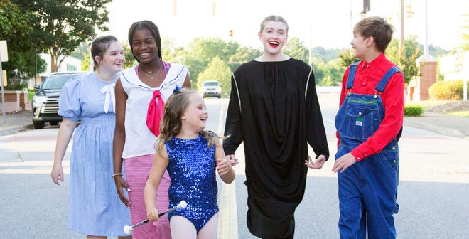 Some members of the cast of 'Charlotte's Web' pose on Wall Street, outside the Theatre of Gadsden's Ritz Theatre.