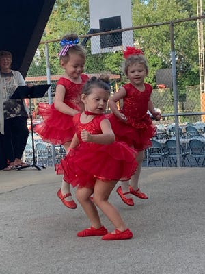 """Ezrah McMorrow (left), Briella Moody (right) and Mila Ridgway (front) won first place in the Gnadenhutten Fireworks Festival Talent Show with their dance to """"The Floor is Lava."""" All are 3 years old."""