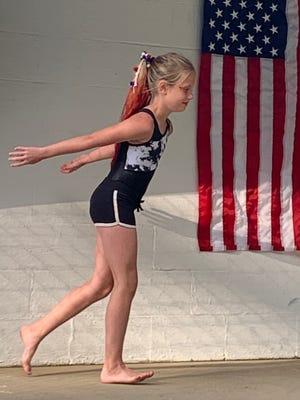 Ellelynie McKibben performs a gymnastics routine at the Gnadenhutten Fireworks Festival Talent Show.