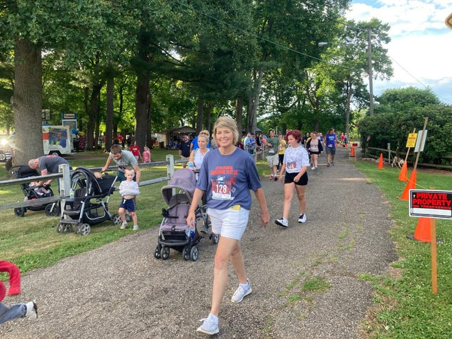Lung transplant recipient Jacquie Price walks in the Tomahawk Trot 5k held as part of the Gnadenhutten Fireworks Festival. Photo courtesy of Alicia Povick
