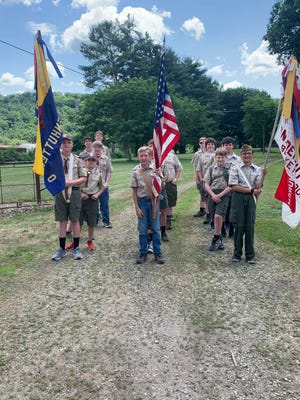 Boy Scout Troop 429 waits to join the Gnadenhutten Fireworks Festival grand parade.
