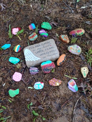 The Doster family buried Charlotte in a grave in their yard marked with stones to commemorate her passing.