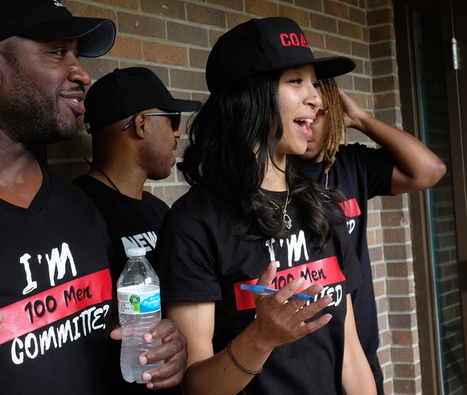A'Jai Necole James talks to community members at the Letts Community Center about getting involved with programs designed to stop youth violence and deaths in the Lansing area Saturday, July 3, 2021.
