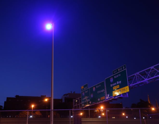 A purple streetlight is seen near the 400 block of North 15th Street in Milwaukee on Friday. Many residents have noticed purple-hued streetlights on the interstate throughout the Milwaukee area. There is a technical glitch in the LED bulbs installed by the state Department of Transportation roughly three years ago, and they will be replaced.