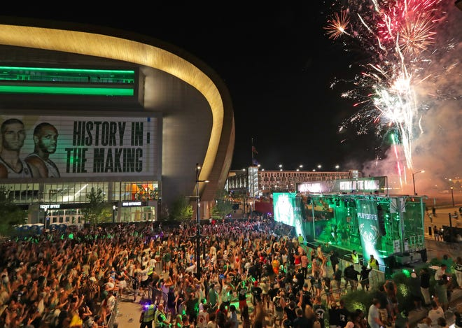 Fireworks light off after the game as fans gather in Deer District outside Fiserv Forum in Milwaukee after the Milwaukee Bucks 118-107 victory over the the Atlanta Hawks in the Eastern Conference finals on Saturday, July 3, 2021 to advance to first NBA Finals since 1974.