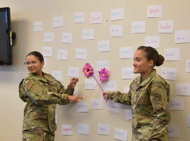Cadet Patria Navedo and Cadet Alanis Delgado, Puerto Rico Project Language participants, play a grammar and vocabulary game during class at Maxwell Air Force Base, Alabama, June 25, 2021. The fly swat word game is a word comprehension game that gives the cadets practice and familiarity with words that would potentially be on the Air Force Officer's Qualification Test.