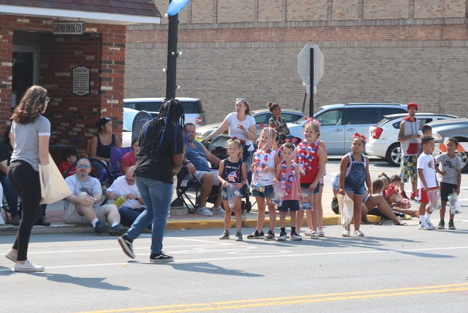 In downtown Fremont on Saturday morning, hundreds of area families lined both sides of Front Street for several blocks for a chance to see the return of the city's annual Fourth of July parade.