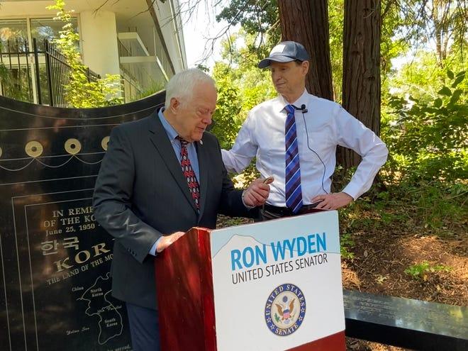 An emotional John Taggart receives the Korean Defense Service Medal from U.S Senator Ron Wyden at the Oregon Department of Veterans Affairs Korean War Memorial.
