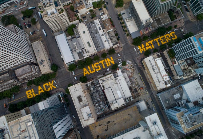 Painted on Congress Avenue on June 16, 2020, the words Black Austin Matters represented a statement on racism and police mistreatment of Blacks. [JAY JANNER/AMERICAN-STATESMAN]