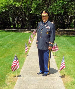 Retired U.S. Army Lt. Col. Barnard Kemter is pictured at Markillie Cemetery in Hudson before giving the keynote address at the Memorial Day ceremony on May 31. Kemter's microphone was turned down by ceremony organizers from the Hudson American  Legion and the Hudson American Legion Auxiliary as he spoke about Black Americans' involvement in an early Memorial Day ceremony.