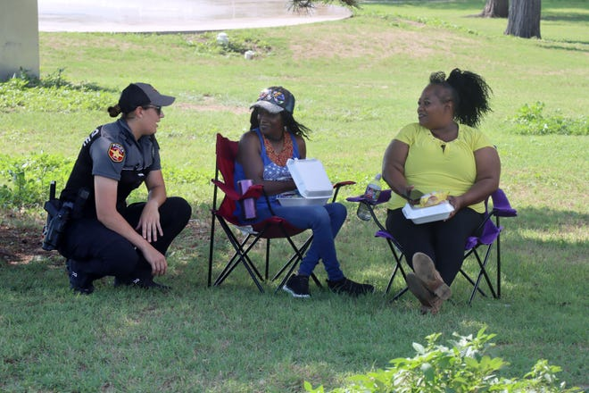 Officer Amanda Williams visits with Clytia and Kristy Edwards during the July 4th Celebration in Hamlet hosted by the Amarillo Police department at Hamlet Elementary School Park Sunday afternoon.
