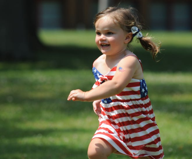 Stella Baia, 2, runs Sunday on a warm summer day during the 2021 Fourth of July celebration at the Sebring Community Center.