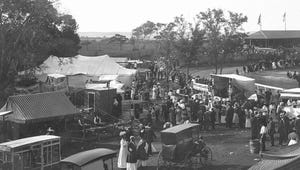 Fancy outfits and a vintage ice cream truck, at the Barnstable County Fair, c. early 1900s, in Barnstable Village, with a view of Massachusetts Bay at the top of the photo.