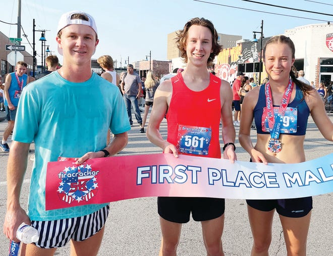 Bartlescville High grad Henry Williams, center, stormed to first place last weekend in a prestigious Tulsa run that featured approximately 1,500 runners. Helping him celebrate are his borther Max —who finished fifth overall — and sister Liza.