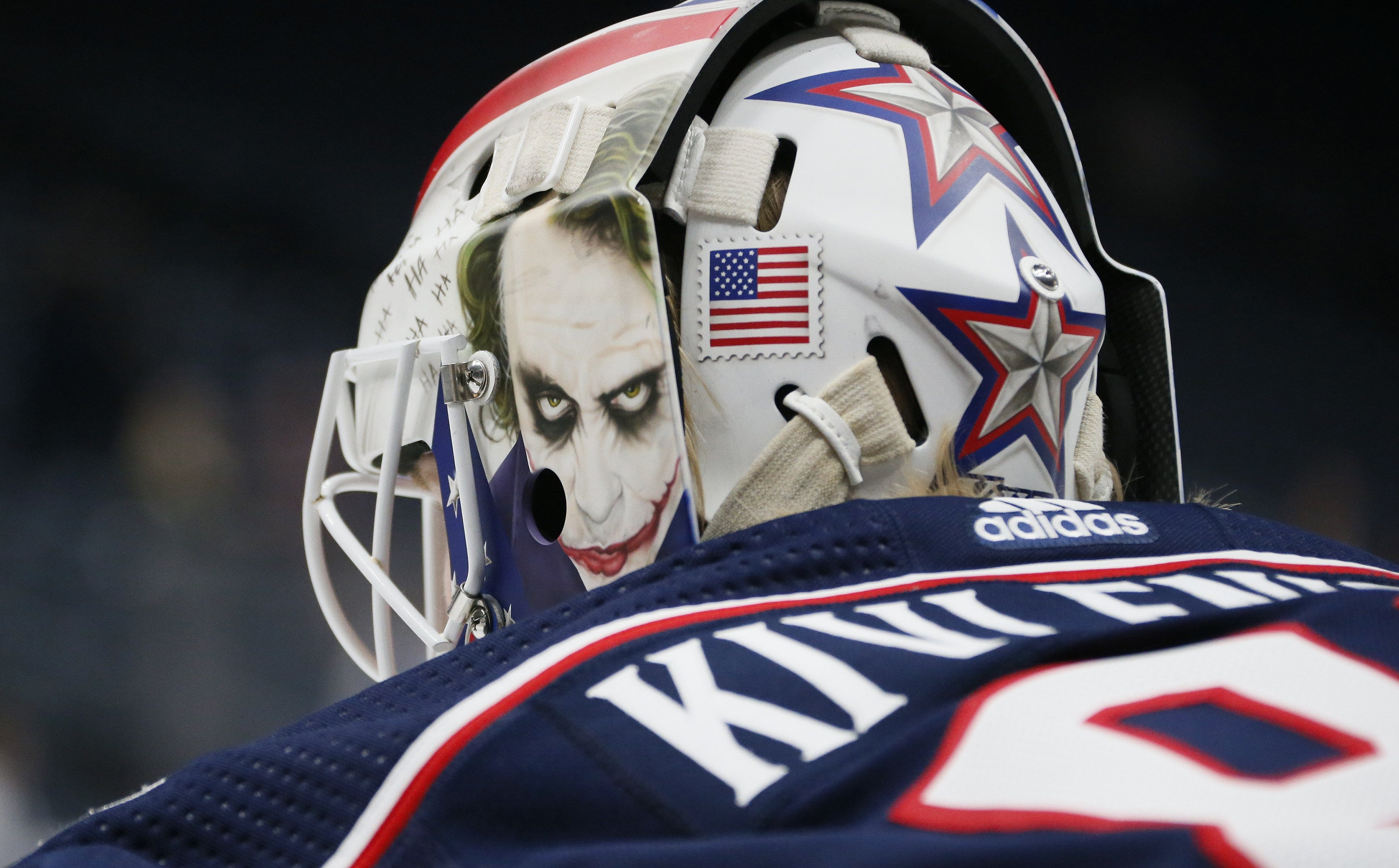 Matiss Kivlenieks warms up with a mask featuring the Joker prior to the preseason NHL hockey game against the Buffalo Sabres at Nationwide Arena in Columbus in 2019.