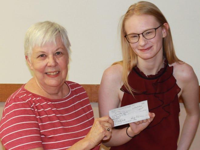CCT President Gaye Wick gives Jazmine Doyea her scholarship check.