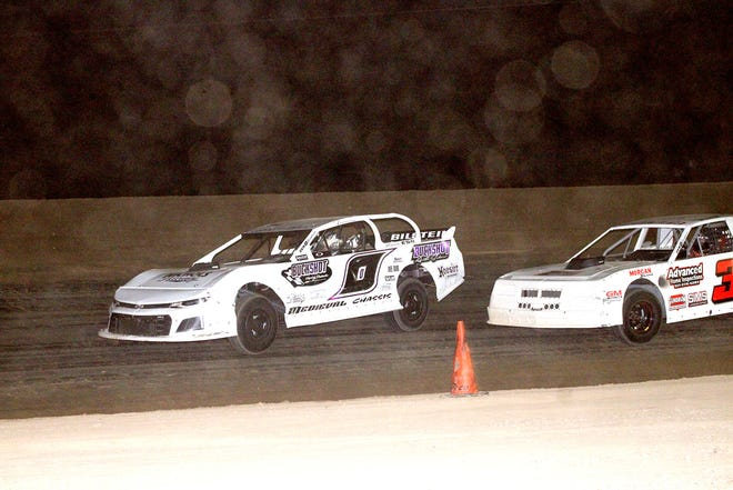 In a close battle for the lead Tim Wilber (0) battles with Jake Wilber (3) both of Coldwater during Saturday night's street stock feature.