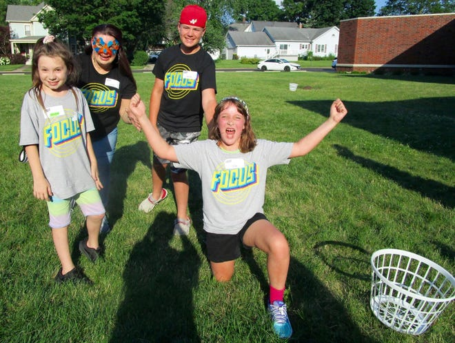 Games were a highlight of VBS at First Methodist and having fun in one of the outdoor activities are from left, Gracie Wilson, Abby Mooney, co-director of VBS; Jaydon Swain and Ella Hepner.