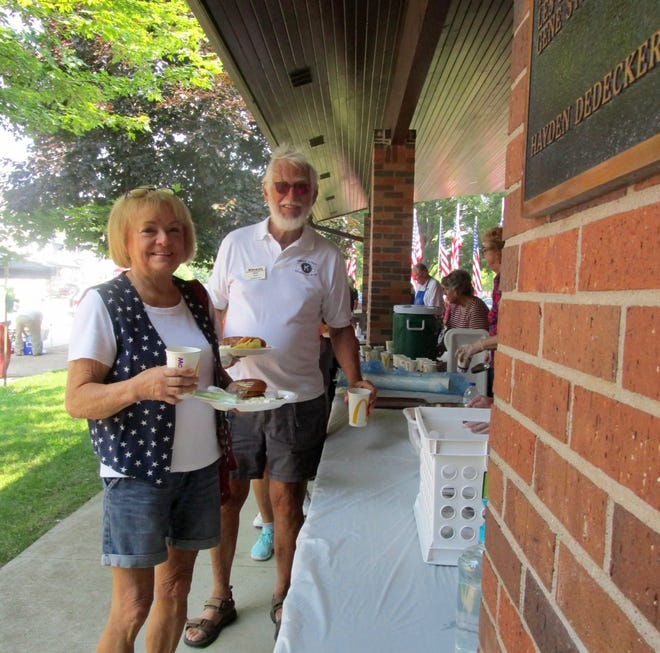 """Ray and Kathy Rogers were among the many people who had lunch at """"Pork in the Park"""" on the Fourth July."""