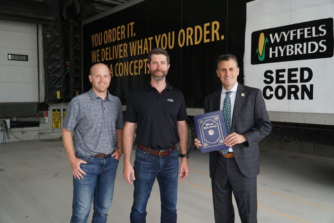 Senator Win Stoller (right) presenting John Wyffels, President of Wyffels Hybrids (center) and Jacob Wyffels, Vice President of Production (left) with a congratulatory certificate recognizing Wyffels Hybrids for 75 years of business. Senator Stoller visited the Wyffels Hybrids Atkinson Production Facility on June 23.