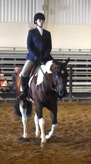 Hannah Maher of AlWood FFA maintains her posture as she guides her horse through the English equitation pattern in the Section 3 horse show on Thursday, July 1, at Black Hawk College, East Campus, Galva.