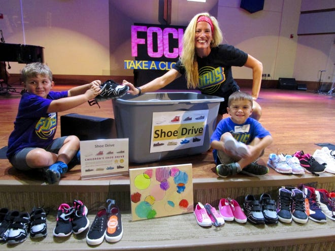 Kamdon Bullock, left; Christina Swain, Director of Children's Ministry at First United Methodist Church in Geneseo; and Cohen Heller, are shown with some of the children's shoes collected during Vacation Bible School at First Methodist. A total of 382 pairs of shoes were collected during VBS Week. The shoes will be donated to Another Child Foundation.