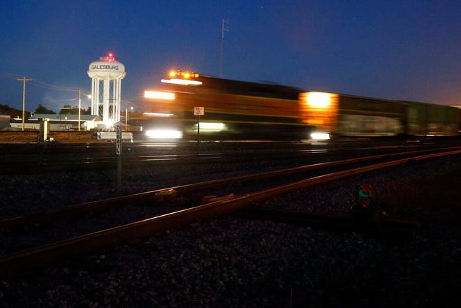 A BNSF freight train passes a Galesburg, Ill., water tower in downtown Galesburg late Wednesday, June 16, 2021. Galesburg, in the heart of the Midwest, the fights in Washington over the filibuster and creating a commission to investigate the events of Jan. 6 seem distant and detached. But in interviews with close to 30 people in Galesburg, conversations are dominated by issues much closer to home, like rising crime, racial strife and whether life can return to an approximation of normal after a deadly pandemic. (AP Photo/Shafkat Anowar)