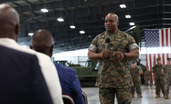 Lt. Col. Kurtis Sargent speaks at a June 11, 2021, change of command ceremony in Albany , Georgia. The 48-year-old Peoria native took command of a U.S. Marines Corps storage battalion.