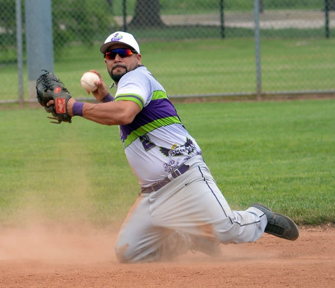 Glowworm second baseman Peter Rodriguez makes a play during the first championship game of the Newton Mexican-American Men's Fast-Pitch Softball Tournament. Rodriguez went three for three hitting in the championship games, hitting a home run and driving in six runs.