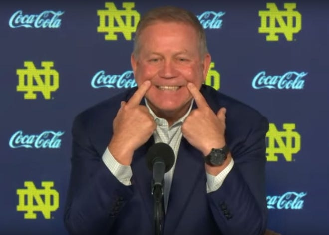 Notre Dame Brian Kelly emphasizes his smile during a Zoom conference call in October 2020 regarding a question about safety Kyle Hamilton.