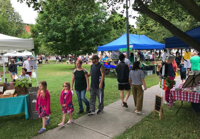 The Farmers Market bustles July 3 shortly before the Fourth of July parade in Hamilton.