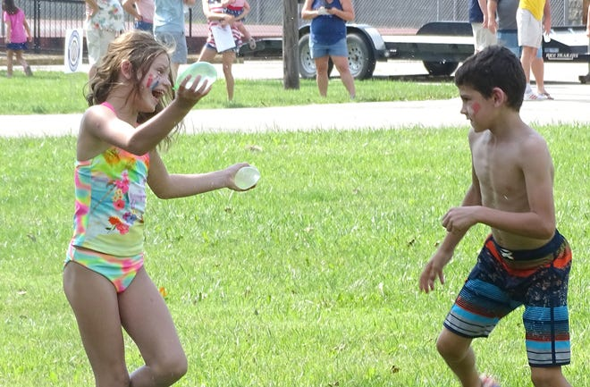 The children stayed cool on the hot afternoon with a water balloon fight using the balloons leftover from the water balloon toss during the Chautauqua Days celebration. Other games included the three-legged race and frog-leaping contest.