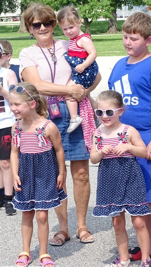 The Chautauqua Days celebration in Forest Park was full of smiles. Cherry Coen and granddaughters cheer on their turtle in the the turtle race.