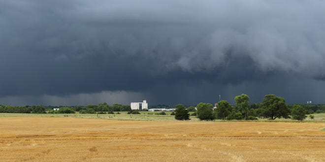 Storm clouds gather over Pratt, dumping much-needed moisture on an area that has seen the tail-end of wheat harvest and the beginning of a month that is normally hot and dry. Cooler temperatures were enjoyed by many after the rain on July 1.
