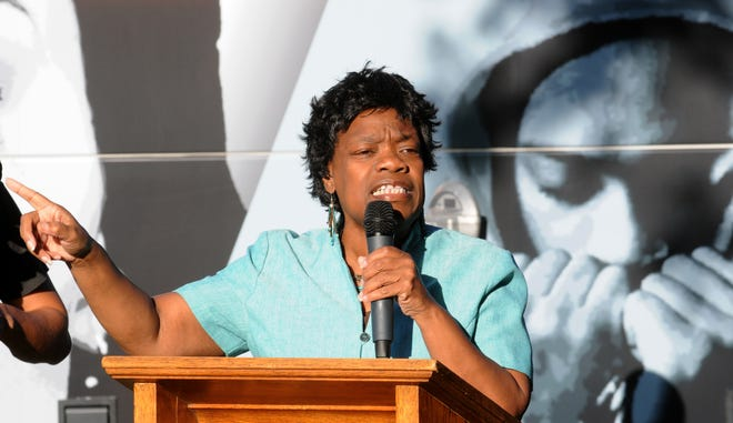 The Rev. Amelia Ann Adams speaks at a prayer rally to commemorate Dr. Martin Luther King Jr. at MLK Plaza in 2013.